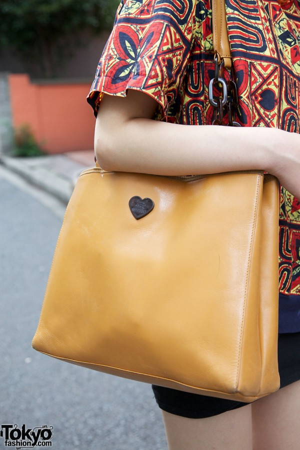 Tan purse with heart cutout from UTA