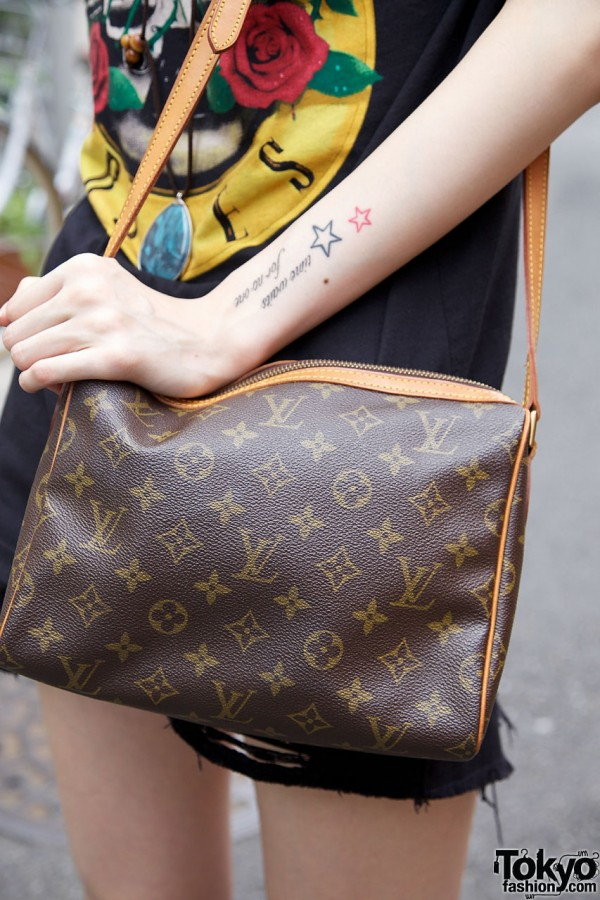 Tattoo and Louis Vuitton Purse