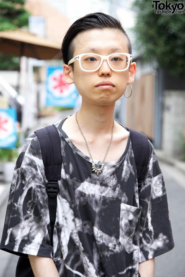 Black-and-white top & white-framed glasses