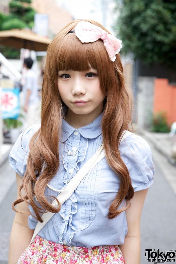 Japanese girl with long auburn hair & pink hair bow