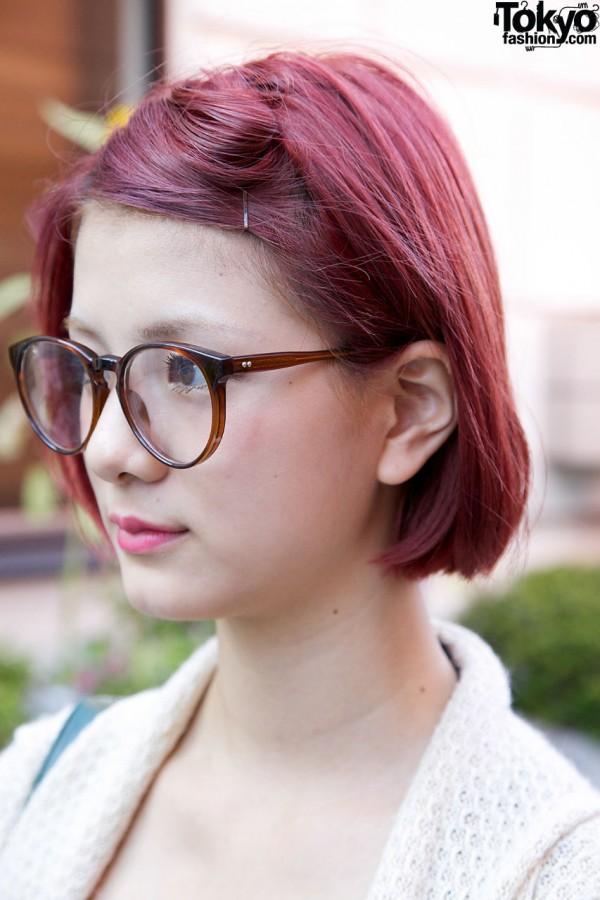 Fuchsia hair & large glasses