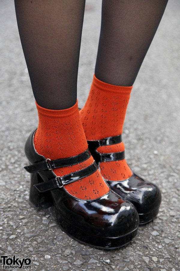 Double strap shoes with orange socks
