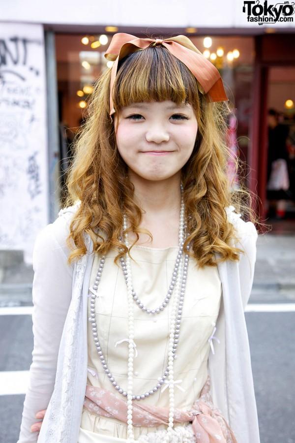 Girl with long curls & hair bow in Harajuku