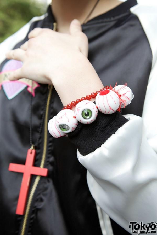 Eyeball bracelet & red cross necklace from Nadia