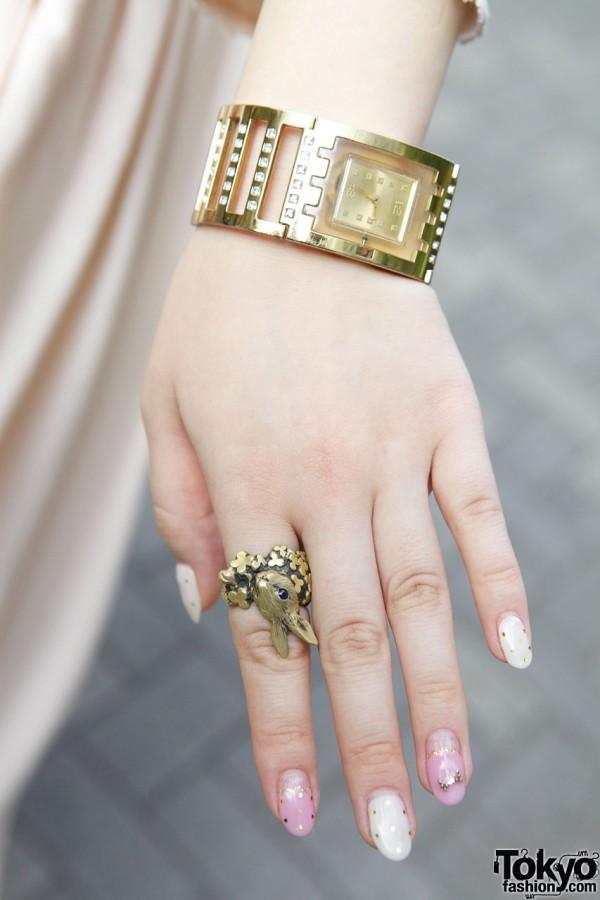 Bunny ring & gold Swatch watch in Shinjuku