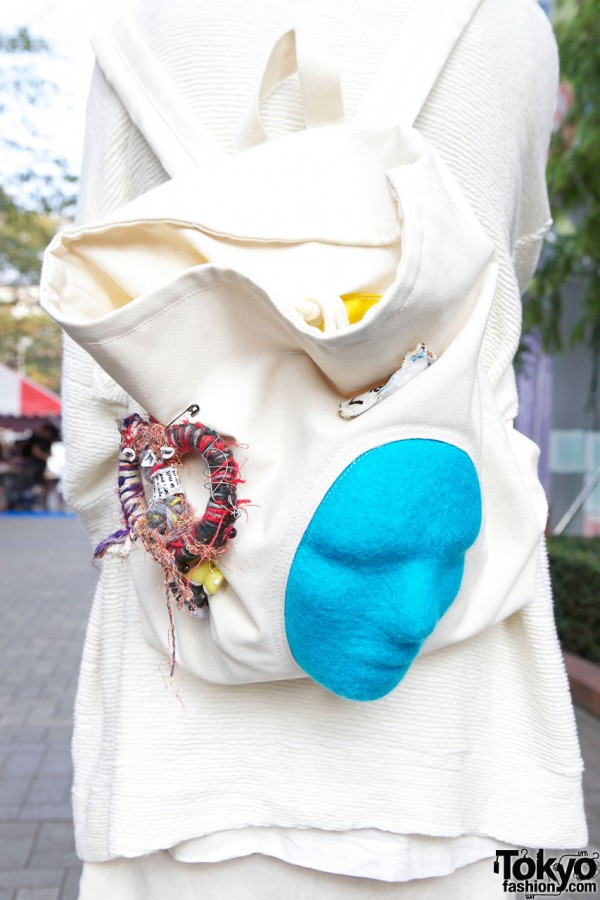 Backpack with blue molded face in Shinjuku