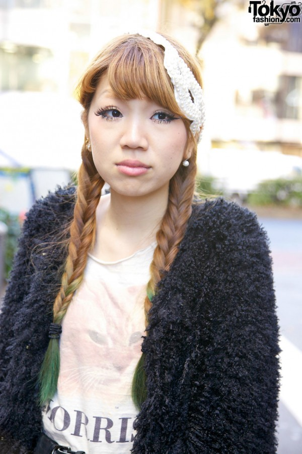 Girl with green-tipped braids & pearl earrings