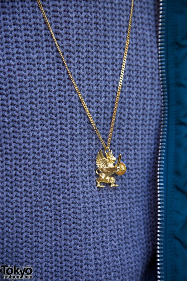Gold necklace w/ mythical figure in Harajuku