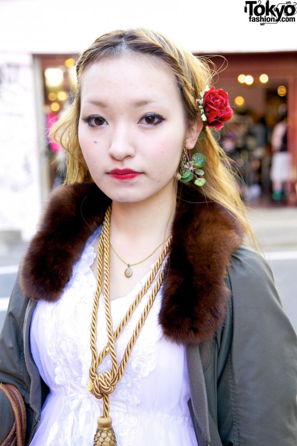 Fur collar, tassel & rose in hair in Harajuku