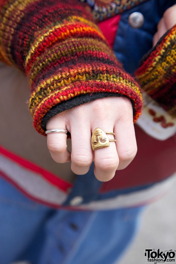 Gold theater mask ring in Harajuku