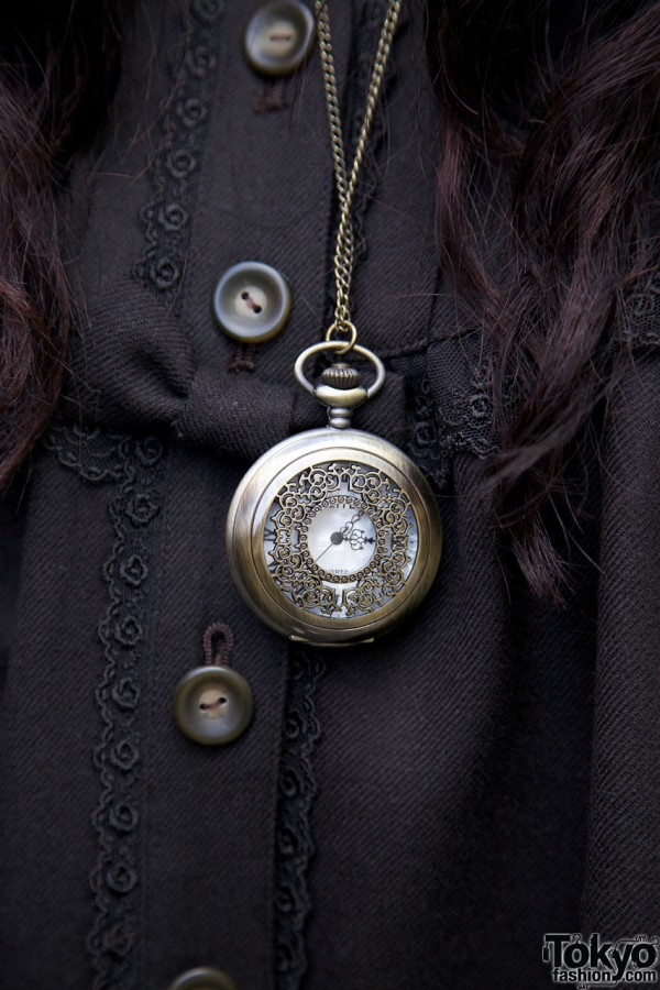 Vintage pocket watch on chain in Harajuku