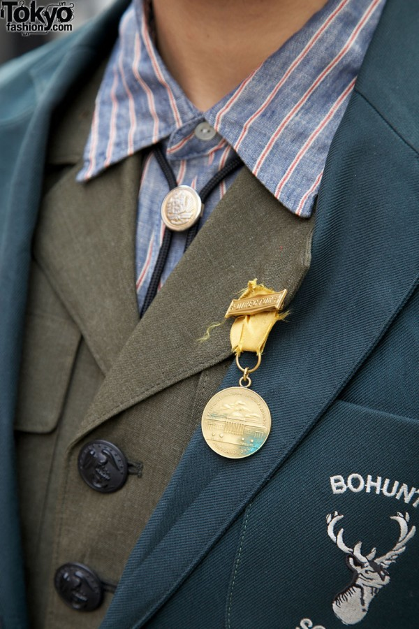 Bolo tie & military medal w/ Mean shirt in Harajuku