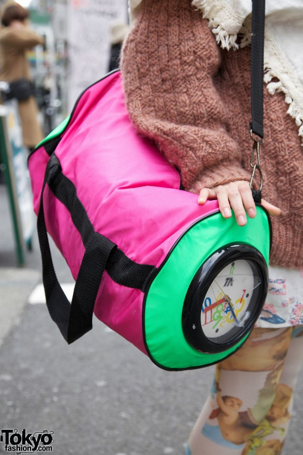 Pink & green duffel bag with a clock
