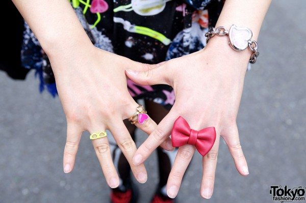 Red bow ring w/ D&G watch