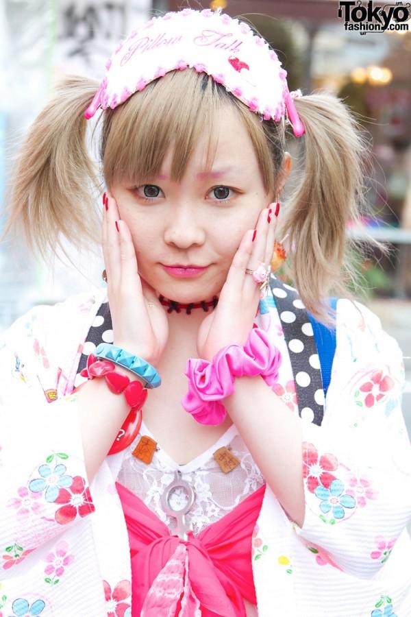 Shushu (scrunchie) on wrist & colorful plastic bracelets