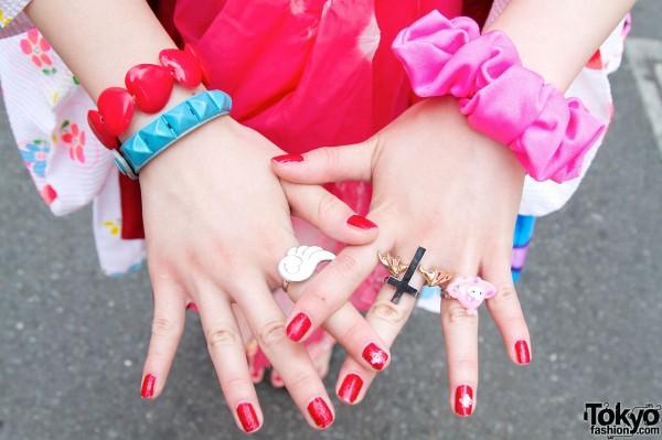 Fun rings & red nail polish
