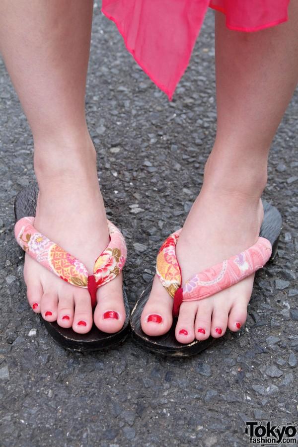 Floral flip flops & red toenails
