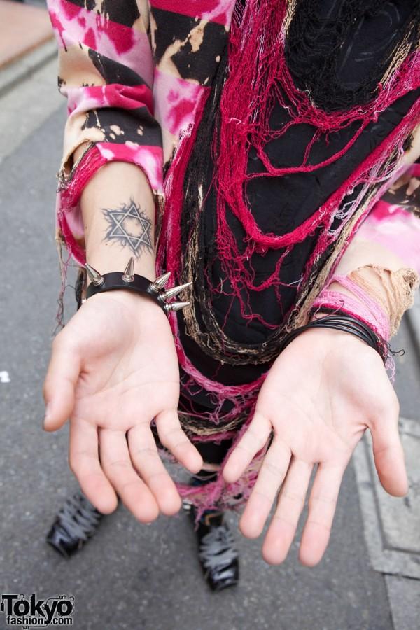 Star of David tattoo & spiked wristband