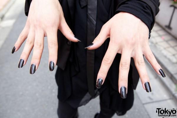 Goth guy w/ black nails