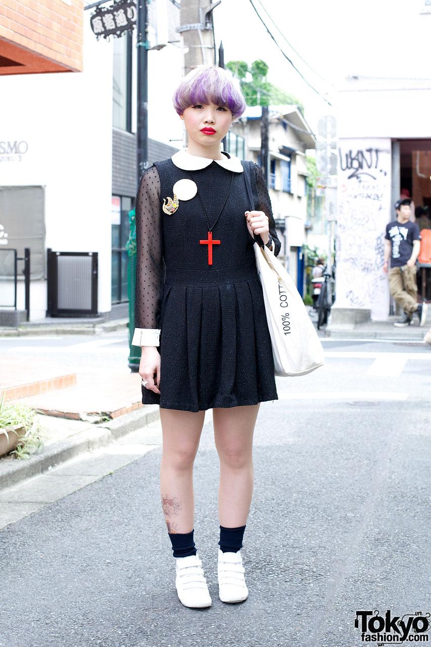 Lavendar-haired girl in black jumper