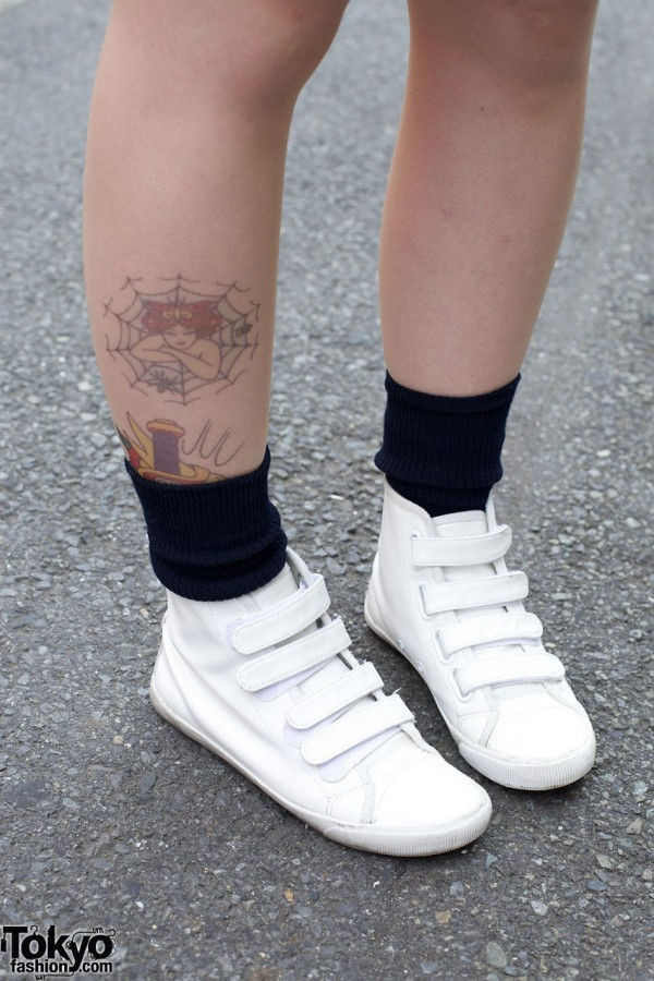Ankle tattoo & white Velcro sneakers