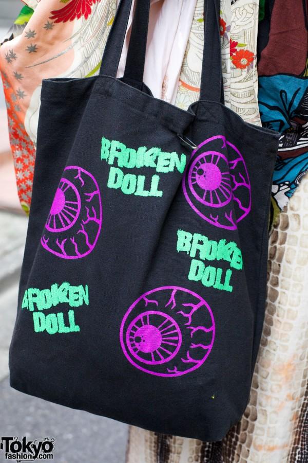 Broken Doll Eyeball Tote Bag
