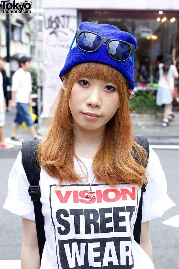 Auburn-haired girl w/ blue knit cap