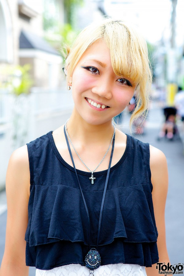 Blond Hairstyle & Cross Necklace
