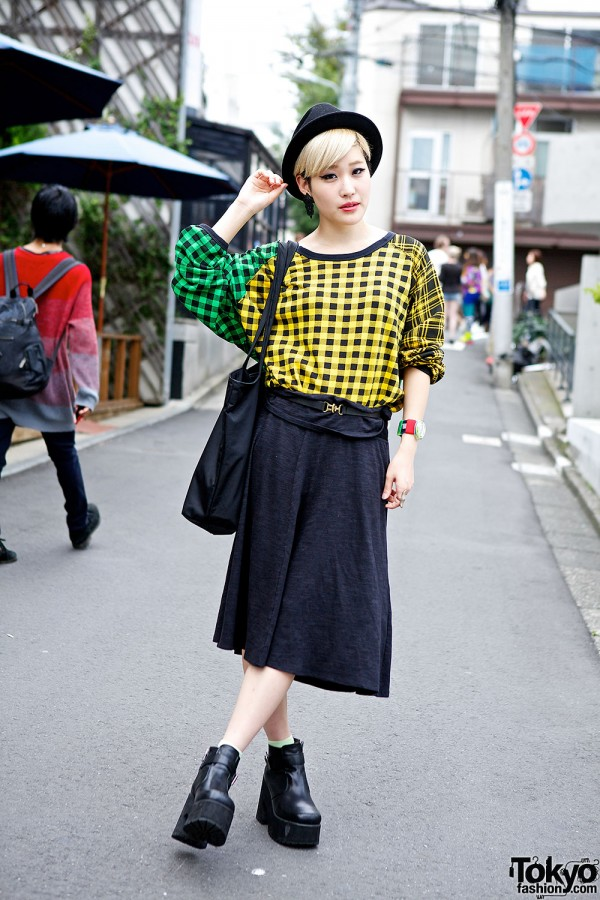 japanese fashion blogger in checkered top midi skirt pin nap ankle boots