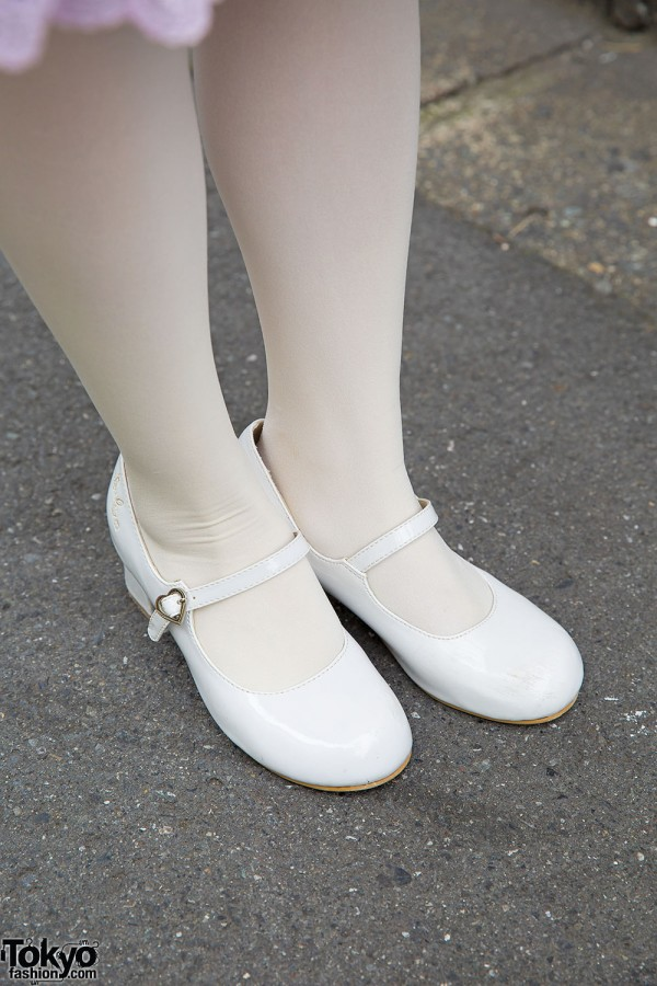 White patent leather Mary Janes with white tights