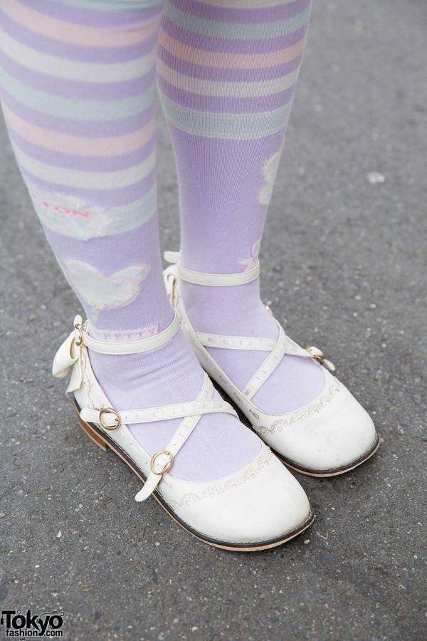 White cross-strap shoes and pastel tights