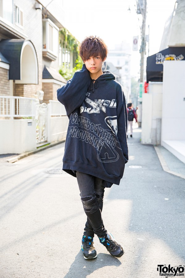 Harajuku Guy In Oversized Hoodie Ripped Jeans Sneakers