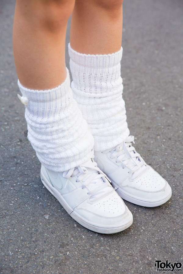 Nike sneakers and leg warmers
