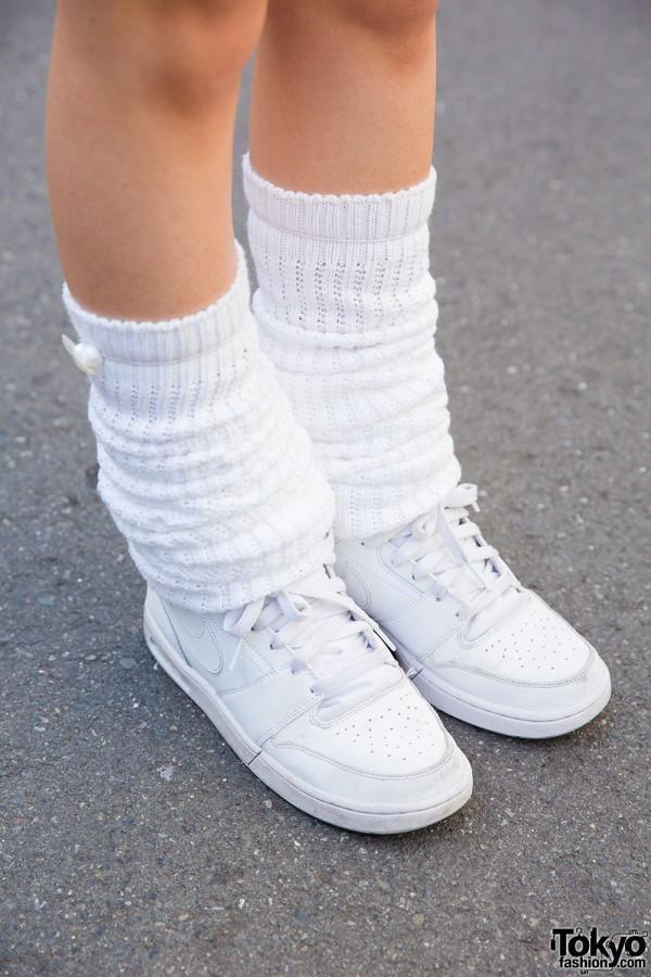 Nike sneakers and leg warmers