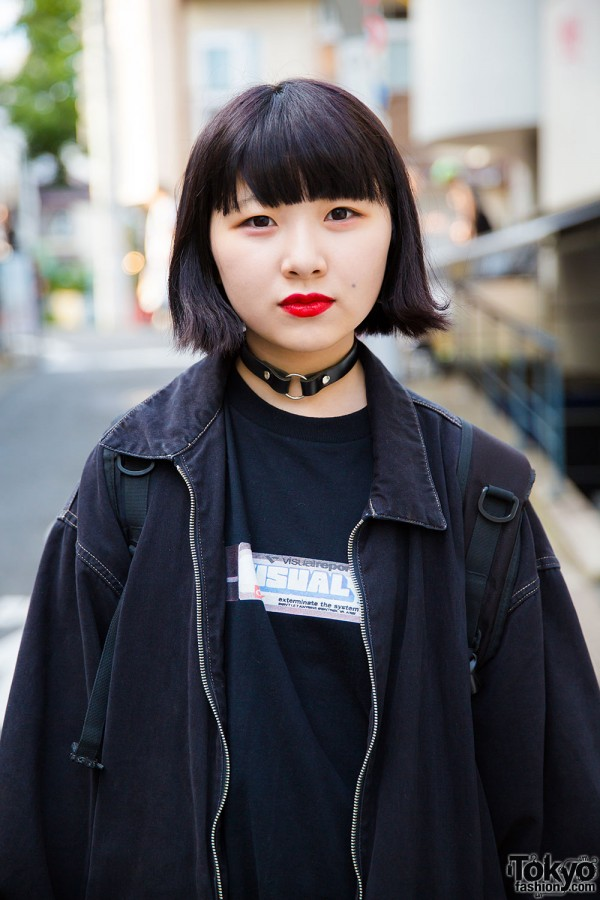 Black t-shirt, jacket, and leather collar