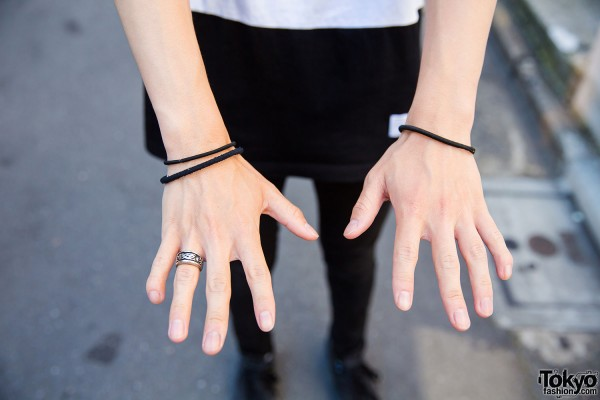 Silver ring and black wristbands