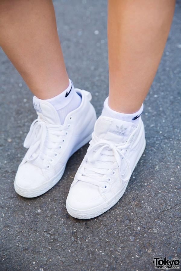 Nike socks and Adidas white kicks