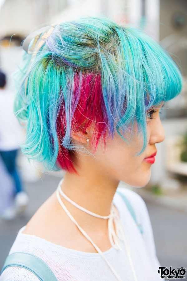 Short, rainbow hair, pearl earring and handmade shoelace necklace