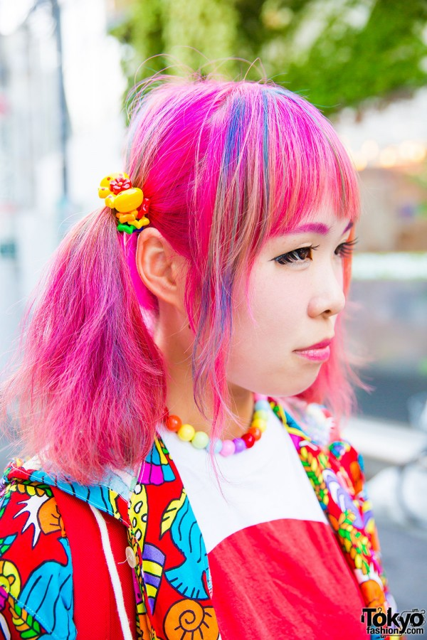 Pink hair in twin tails and colored eyebrows
