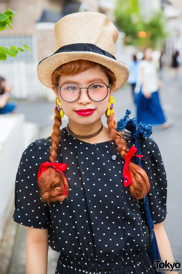 Override top hat, resale polka dot dress, oversized glasses and twin braids