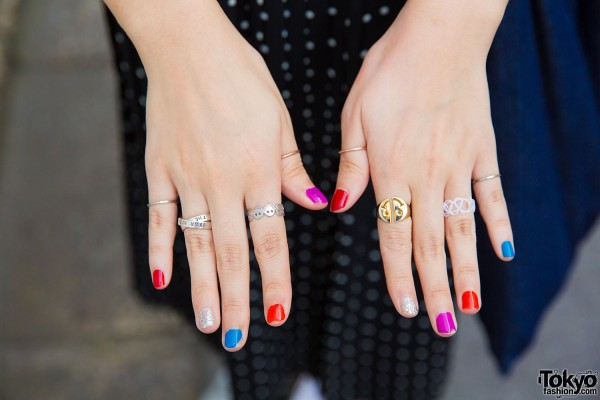 Colorful nails and multiple rings