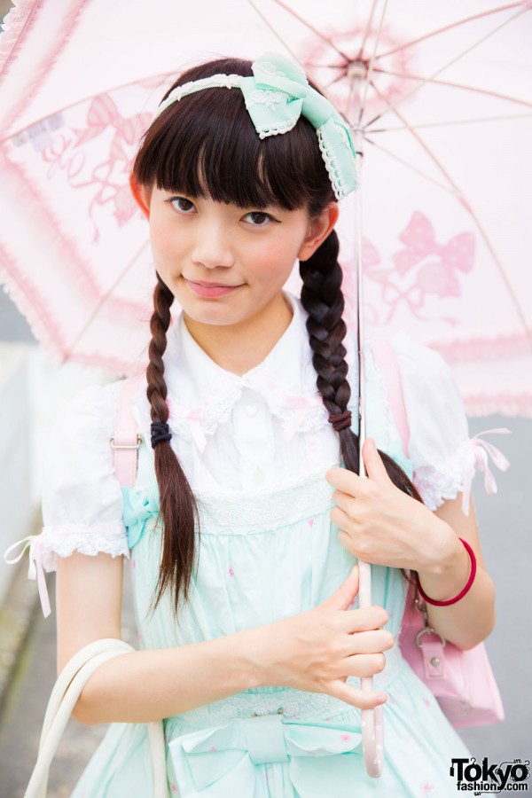 Cute pink parasol, twin braids with blunt bangs
