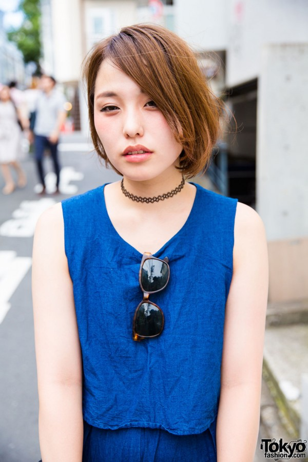 Denim sleeveless top, tattoo choker and tortoiseshell sunglasses