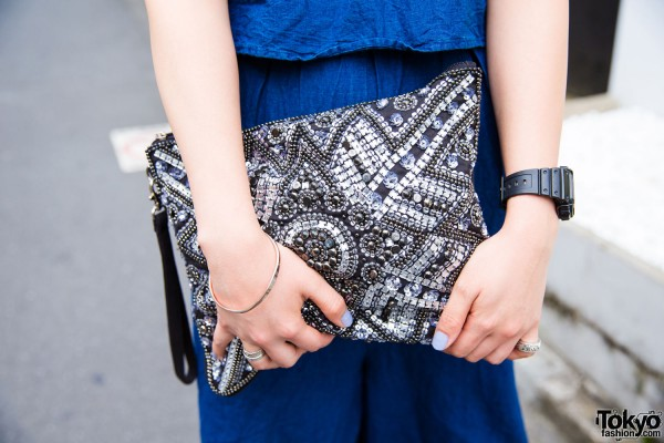 Embellished clutch and G-Shock watch