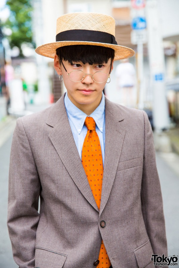 Collar shirt, polka-dot necktie and camel coat