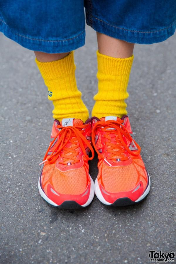 Yellow socks and New Balance running shoes