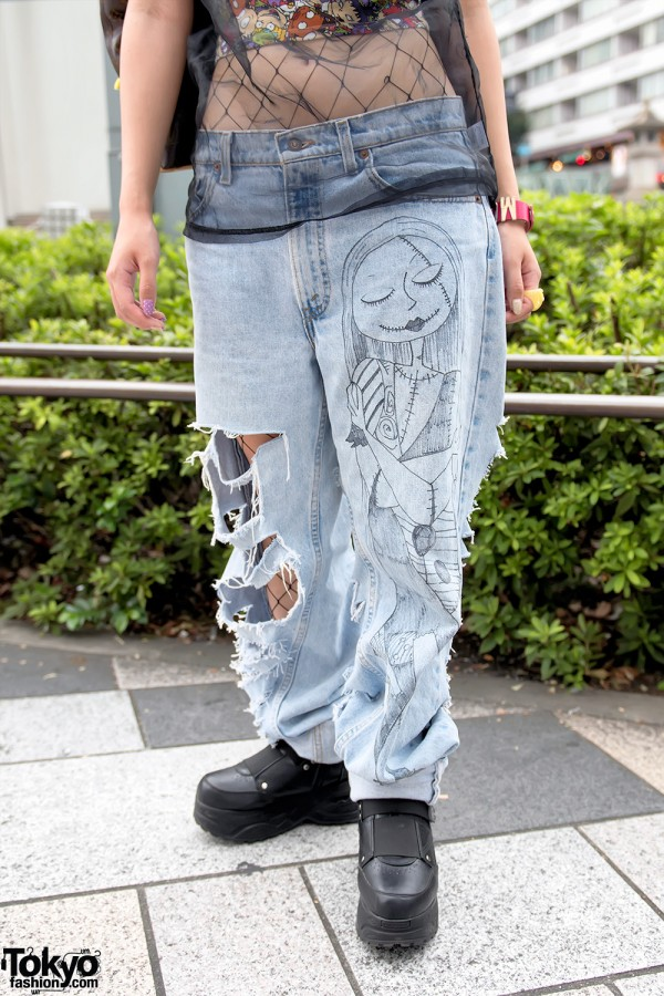 harajuku girl in ripped jeans over fishnets flame