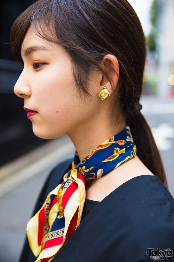 Gold earrings and scarf