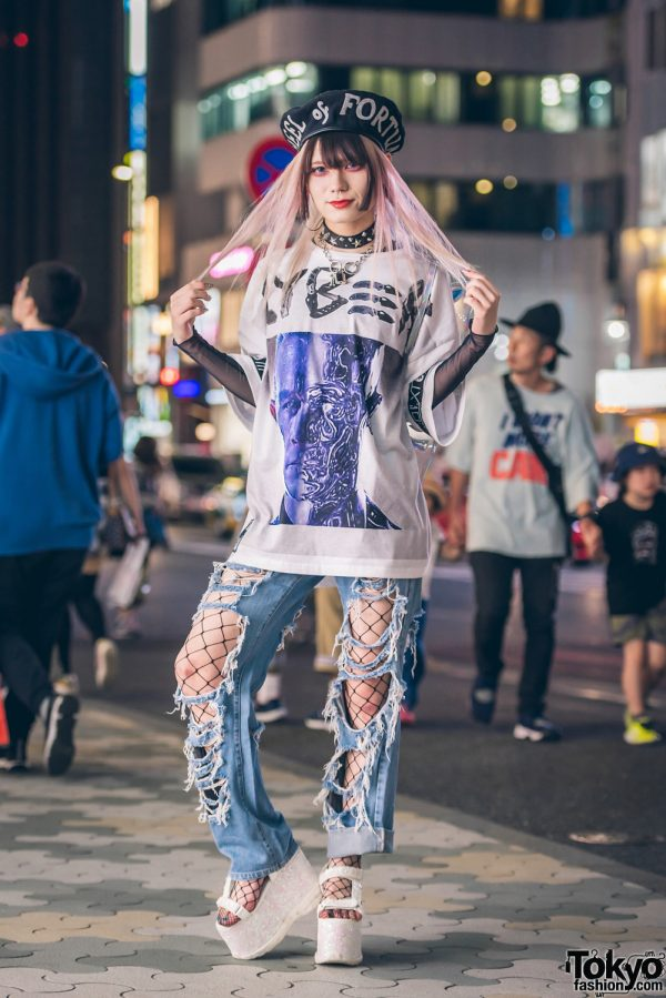 "KTZ ""Wheel Of Fortune"" Hat, DVMVGE ""Cyber"" Tee, Bubbles, Ripped Denim & Swankiss Sandals in Harajuku"