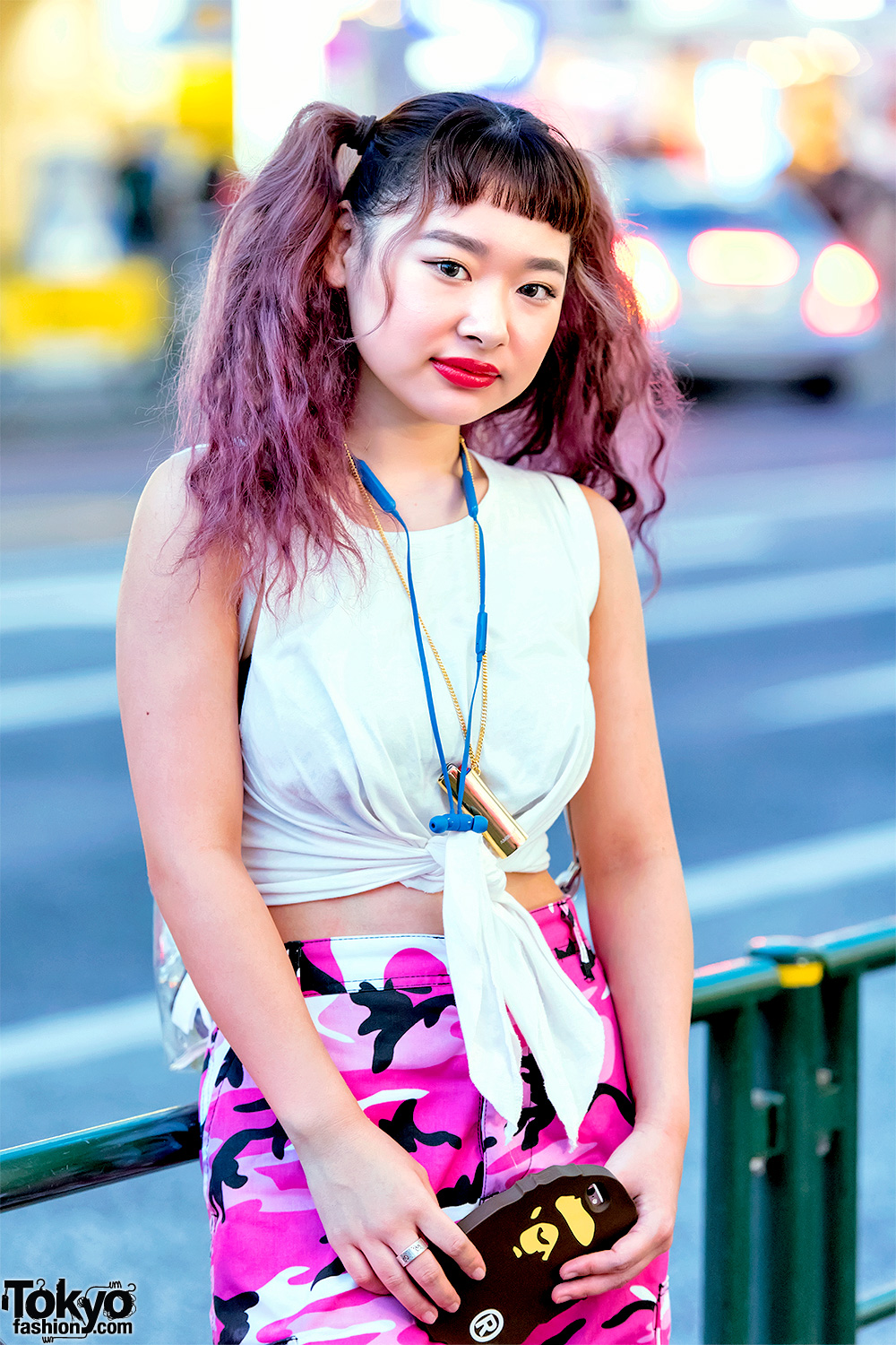 59aa7aef19a4 Her bag choice is a leather and plaid backpack and she's also wearing a  jeweled choker and sunglasses. Her favorite fashion brand is UNIF.